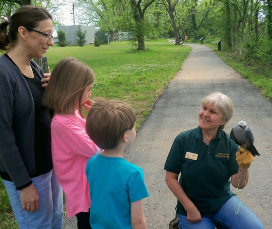Hulya Onel, Walter B. Jacobs Memorial Nature Park Naturalist, shares some of the wildlife of the park with a visiting family.