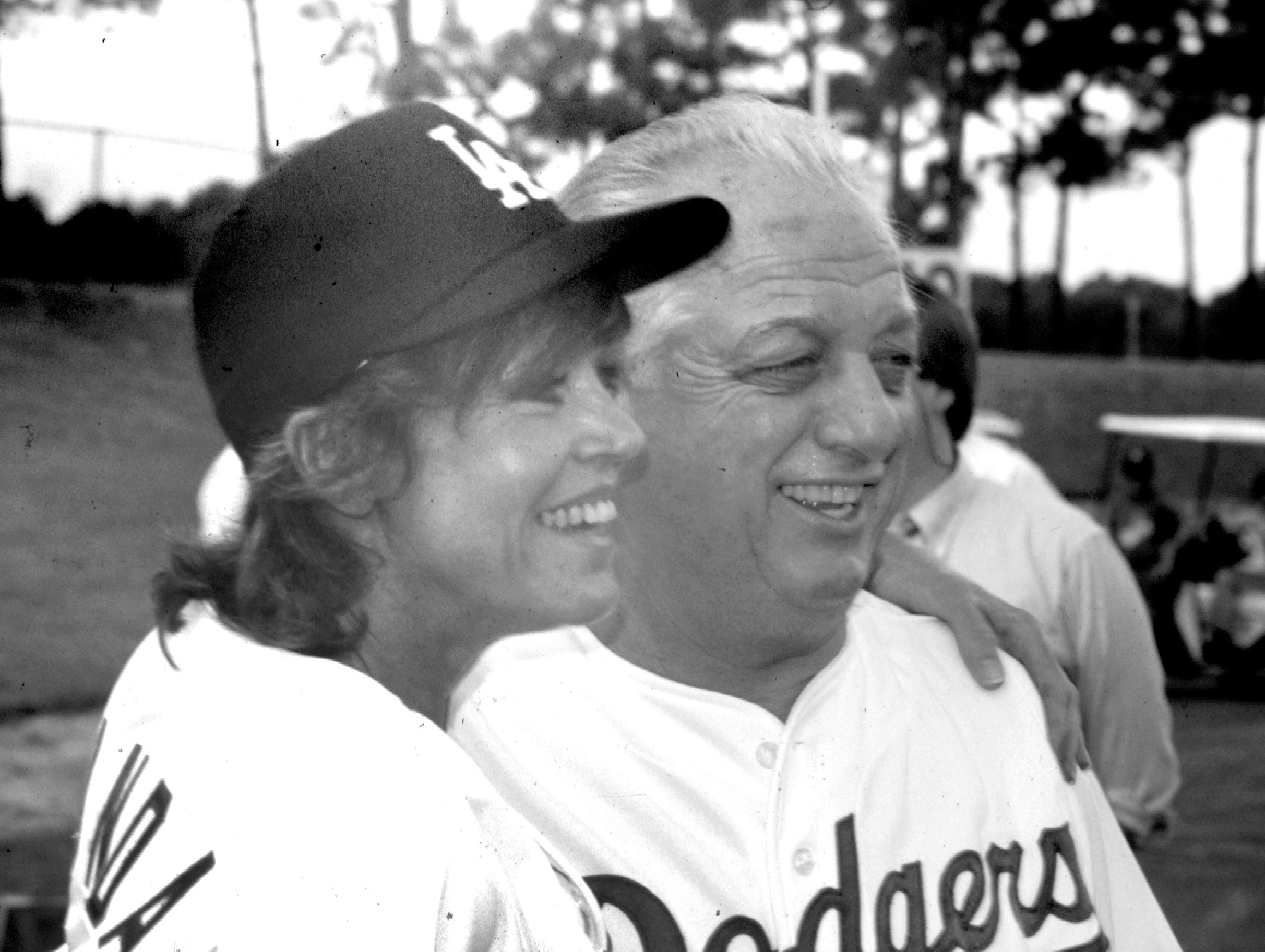 Jane Fonda poses for a picture with Los Angeles Dodgers manager Tommy Lasorda in November 1986 during an Adult Baseball Fantasy Camp held at Dodgertown in Vero Beach. She traveled with her her husband Tom Hayden who was participating in the camp.