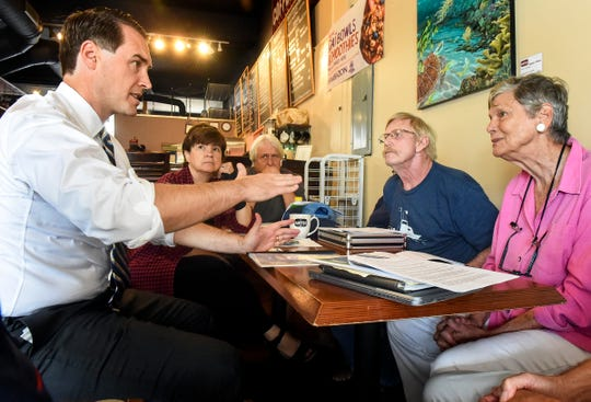 "Chris King (from left) discusses toxic discharges into local waterways and their effects Friday, July 27, 2018, with Martin County residents and environmental activists Dr. Edie Widder, Jerry Buechler, Marty Baum, and Maggy Hurchalla during an ""algae roundtable"" discussion at Stuart Coffee Co. King is now the running mate of gubernatorial candidate Andrew Gillum."