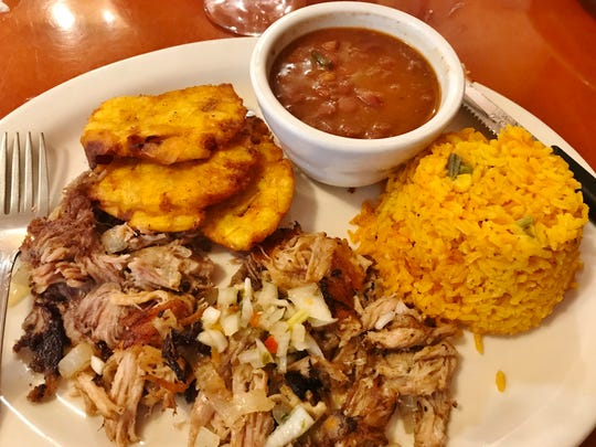 El Cubanito's Slow Roasted Shredded Pork was slow cooked in mojo sauce. It was served with red beans, yellow rice and tostones (smashed, pan-fried plantains.)