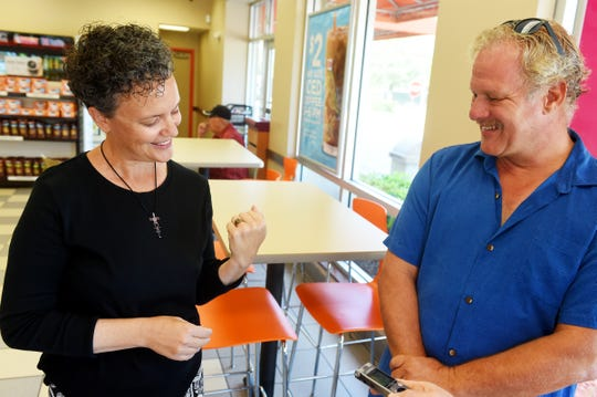 """Elizabeth Engel-Petric marvels at her lost 1995 Florida State University ring recently found and returned to her by amateur treasure hunter Stephen Zabrauskas, of Port St. Lucie, on Friday, July, 27, 2018 at a Dunkin' Donuts store in Port St. Lucie. Zabrauskas was snorkeling off the House of Refuge in Stuart on July 4 when he saw the ring in about 6 to 7 feet of water. Engel-Petric believes she lost the ring about 13 years ago either while swimming or after her car was broken into. """"I'm just amazed at how big this story has become,"""" Engel-Petric said. """"I'm very grateful to Steve (Zabrauskas) for reaching out to return my ring."""""""
