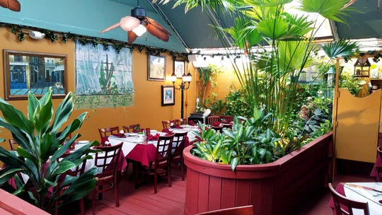 Casa Bella has three dining areas including a cozy alcove, a main living room-like space and a garden area complete with live plants and a running fountain.