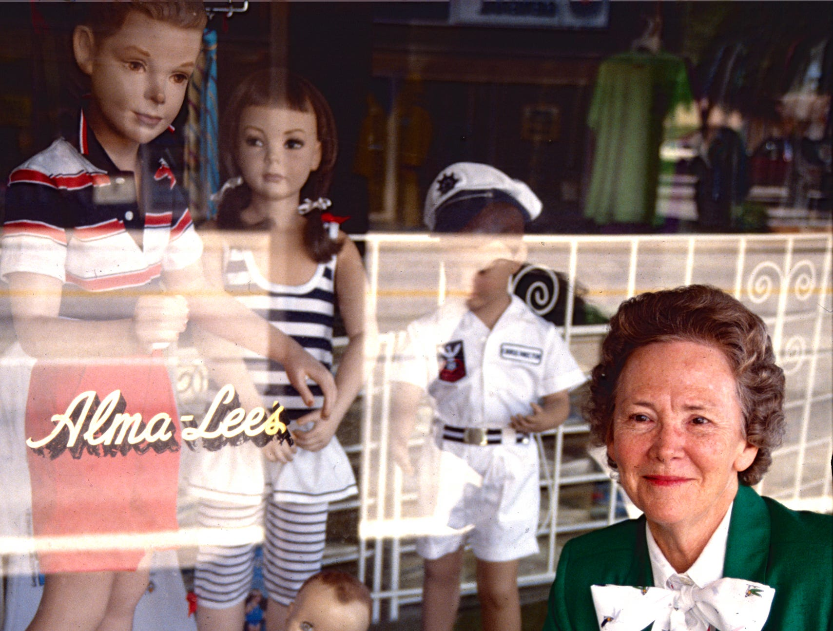 August, 1990 - Alma Lee Loy posed outside her store along S.R. 60, west of 14th Avenue. Lucy Pope Auxier was co-owner with Alma Lee of Alma Lee's Children's Clothing Shop until 1997.