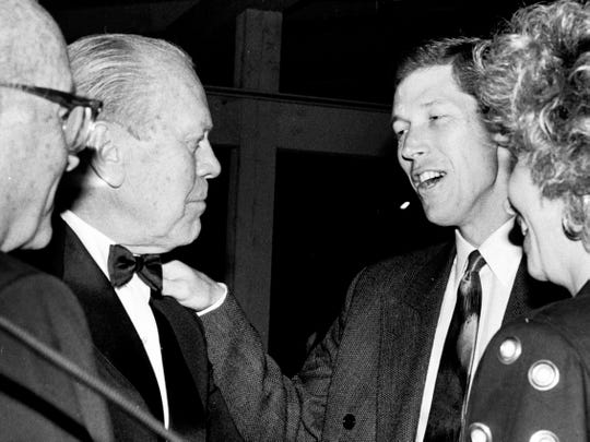 Former President Gerald R. Ford (second from left) and Los Angeles Dodger pitcher Orel Hershiser (second from right) have a conversation in March 1989, during an event in Vero Beach while Ford visited the area.