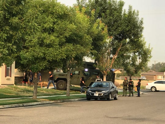Tulare SWAT team members were outside a home near Academy Avenue in Tulare.