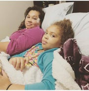 Zoe Dale and her younger sister, Olivia, at St. Jude hospital in Memphis, Tennessee.