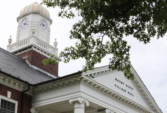 The clock on top of the Village Hall in Mount Kisco photographed at 11:40 AM on Thursday, July 26, 2018.