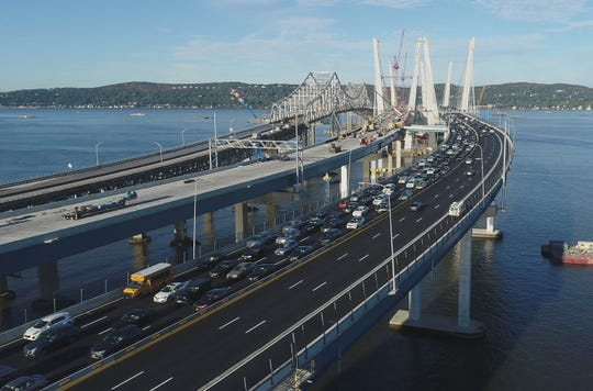 Morning rush hour traffic moves slowly toward Tarrytown on the Gov. Mario Cuomo Bridge Oct. 10, 2017. At far left is the closed Tappan Zee Bridge. In the middle is the second span of the Cuomo Bridge, which will eventually carry eastbound traffic.