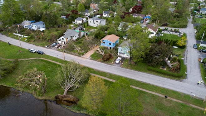 Trees can be seen toppled over with some on houses from the vantage point of a drone around Lake Carmel in the town of Kent in Putnam County, New York on May 17, 2018.