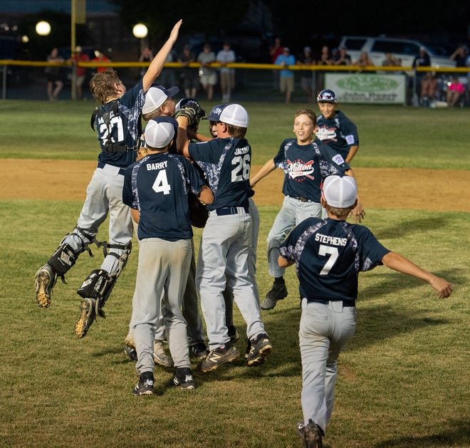Milton celebrates after defeating Newark National in the Delaware Little League Baseball Championship game in Milford.