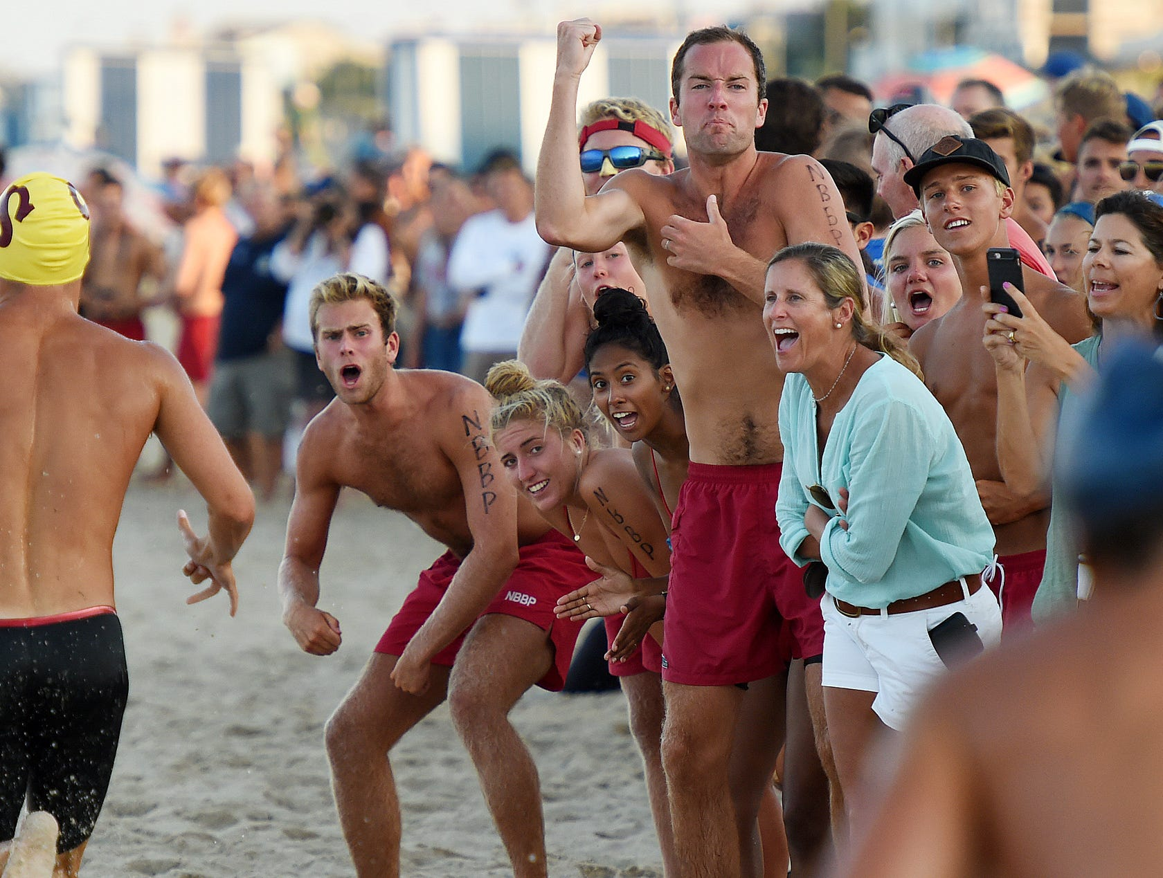 Lifeguards from Rehoboth Beach, Bethany Beach, Dewey Beach, Delaware State Parks, North and South Bethany, Fenwick Island, Sea Colony, Middlesex and Ocean City, Maryland compete in the annual Lifeguard Olympics at Rehoboth Beach on Thursday, July 26.