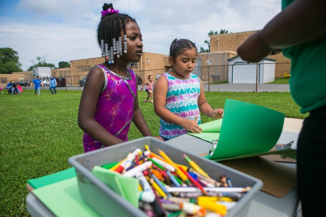 Layla Arthurs (left) and Jimena Gonzalez Coello do some drawing during the Friday water day. Though New Castle County Head Start is free to low-income families, Executive Director Jeffrey E. Benatti says enrollment has declined due to public schools offering similar programs but lacks the comprehensive programs that Head Start offers to the children and families.