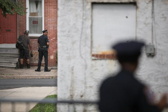 Officers patrol the West Center City neighborhood of Wilmington Friday, July 27.