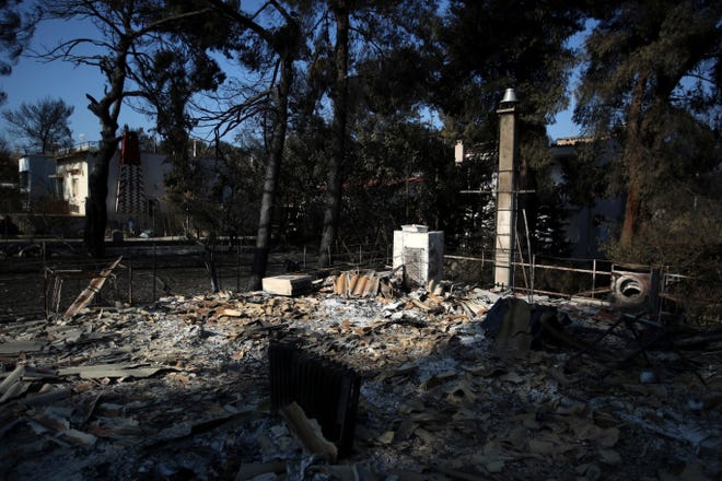 A burnt house in Mati, east of Athens. Greek authorities said Thursday there were serious indications that a deadly wildfire that gutted a vacation resort near Athens was started deliberately.