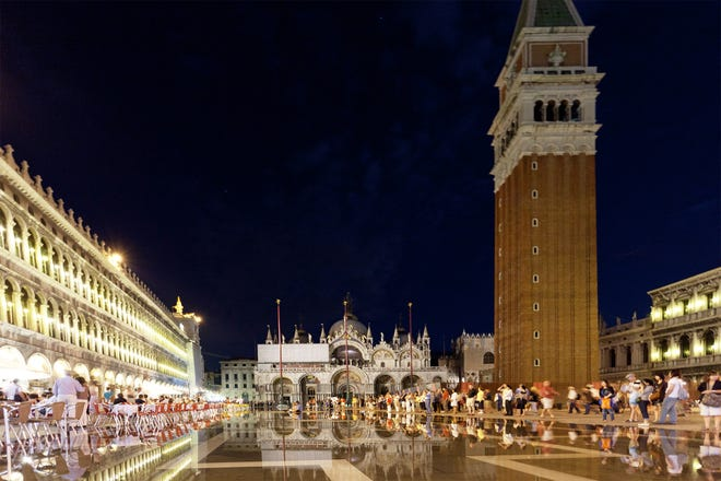 Nighttime on St. Mark's Square comes with ambience-filled cafés, dueling orchestras, and sometimes some atmospheric flooding.