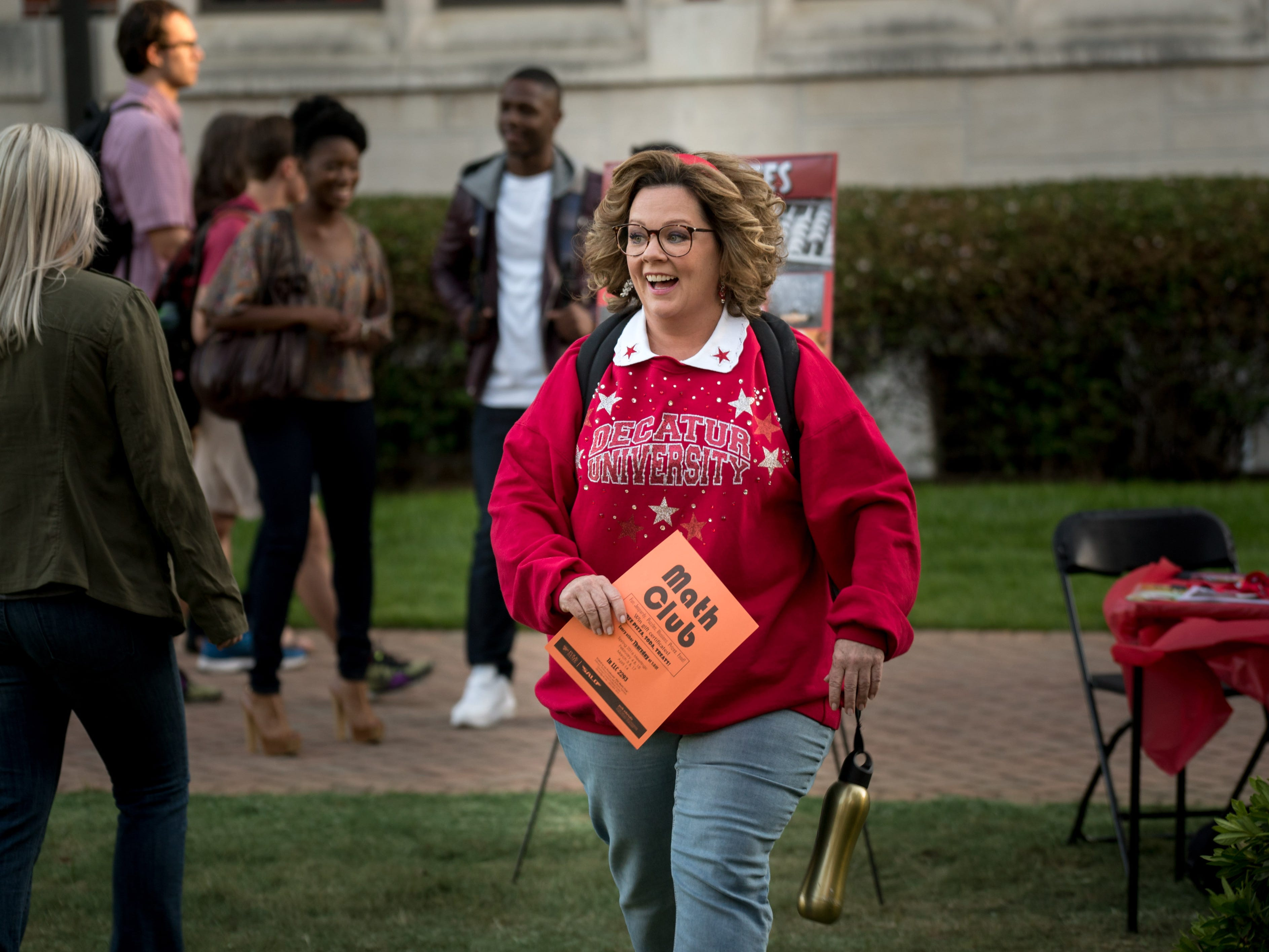 "Deanna (Melissa McCarthy) gives new meaning to the phrase ""old school"" when she goes back to college alongside her daughter in ""Life of the Party."""
