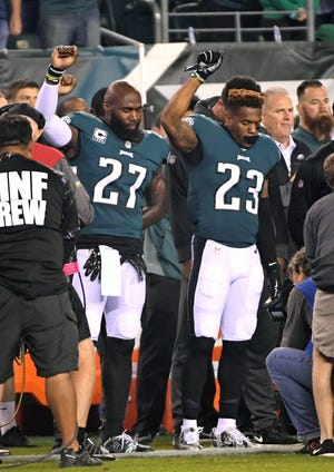 Eagles strong safety Malcolm Jenkins (27) and free safety Rodney McLeod stand in protest during the national anthem.