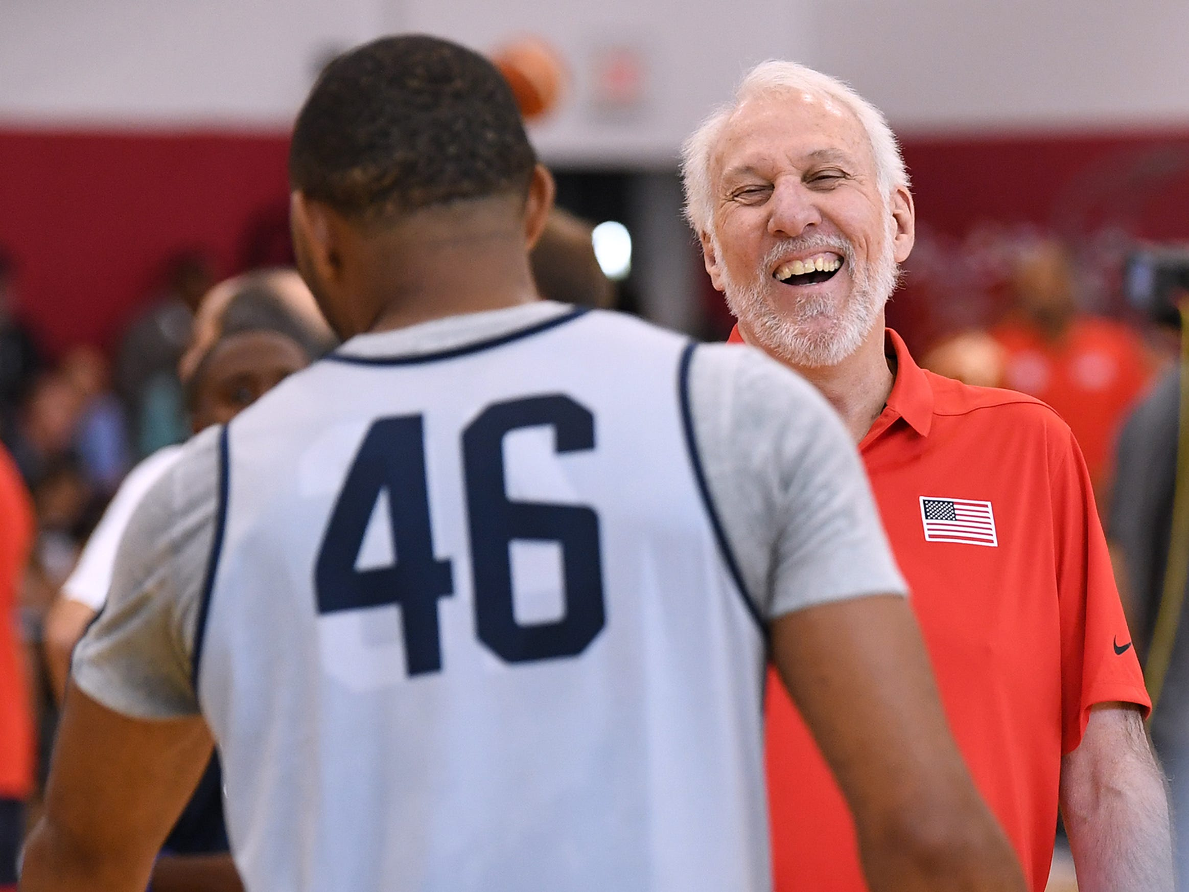 Gregg Popovich laughs with guard Eric Gordon during the 2018 USA Basketball National Team Minicamp.