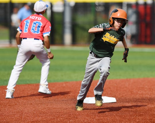 Middletown vs Elmora Youth in the Joe Graziano Little League NJ State Tournament in Secaucus on Saturday, July 28, 2018.  M #16 Jason Quart runs to third.