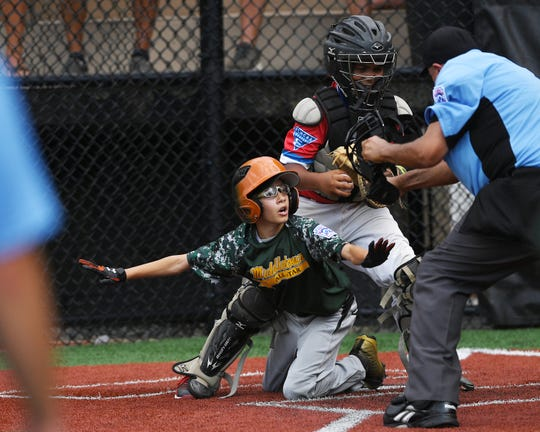 Middletown vs Elmora Youth in the Joe Graziano Little League NJ State Tournament in Secaucus on Saturday, July 28, 2018.  M #16 Jason Quart is out at home.