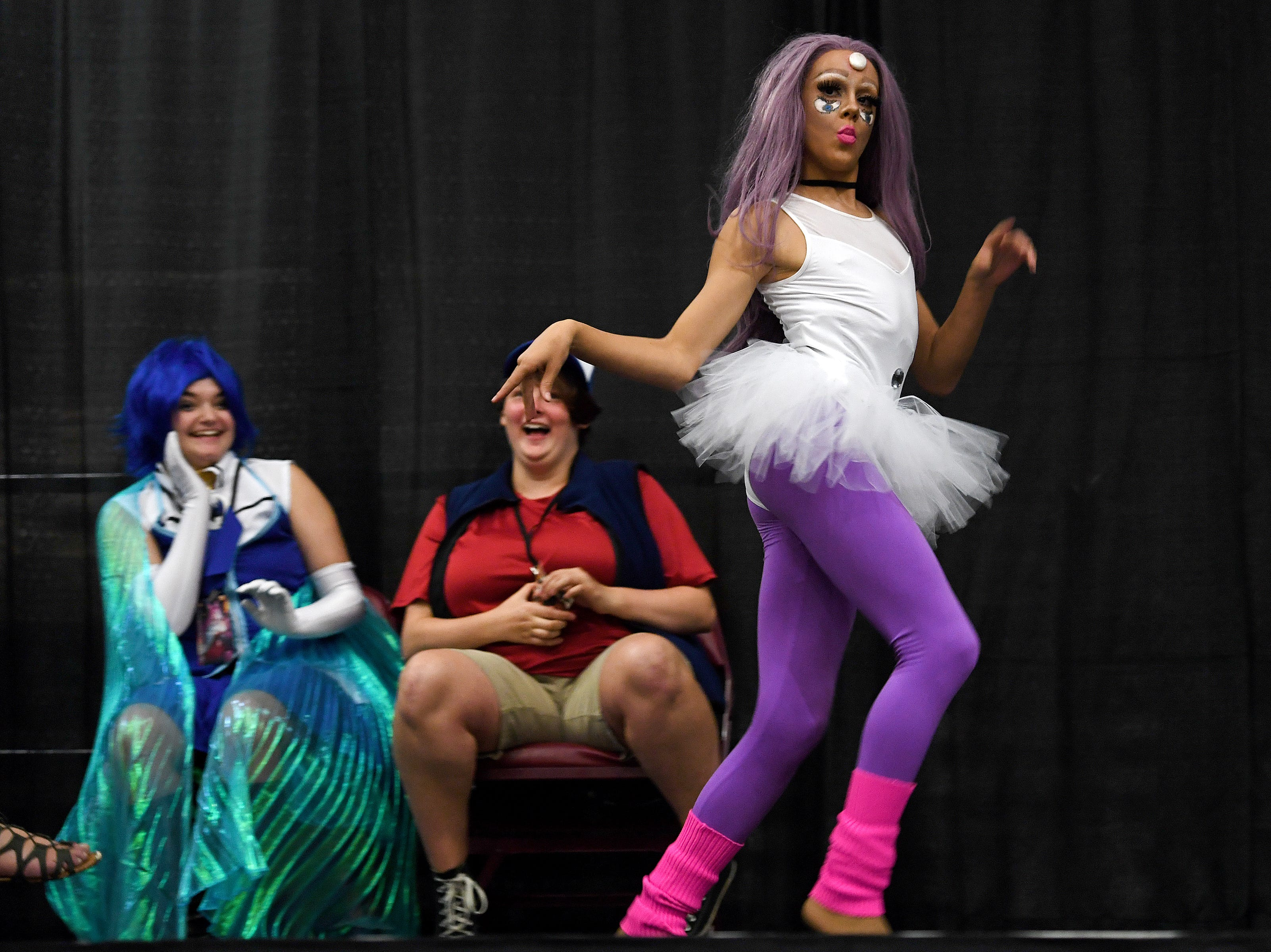 Gage Alexander Filipovic performs in a Cosplay lipsync battle during the Asheville Anime Regional Convention at the U.S. Cellular Center on Saturday, July 28, 2018.