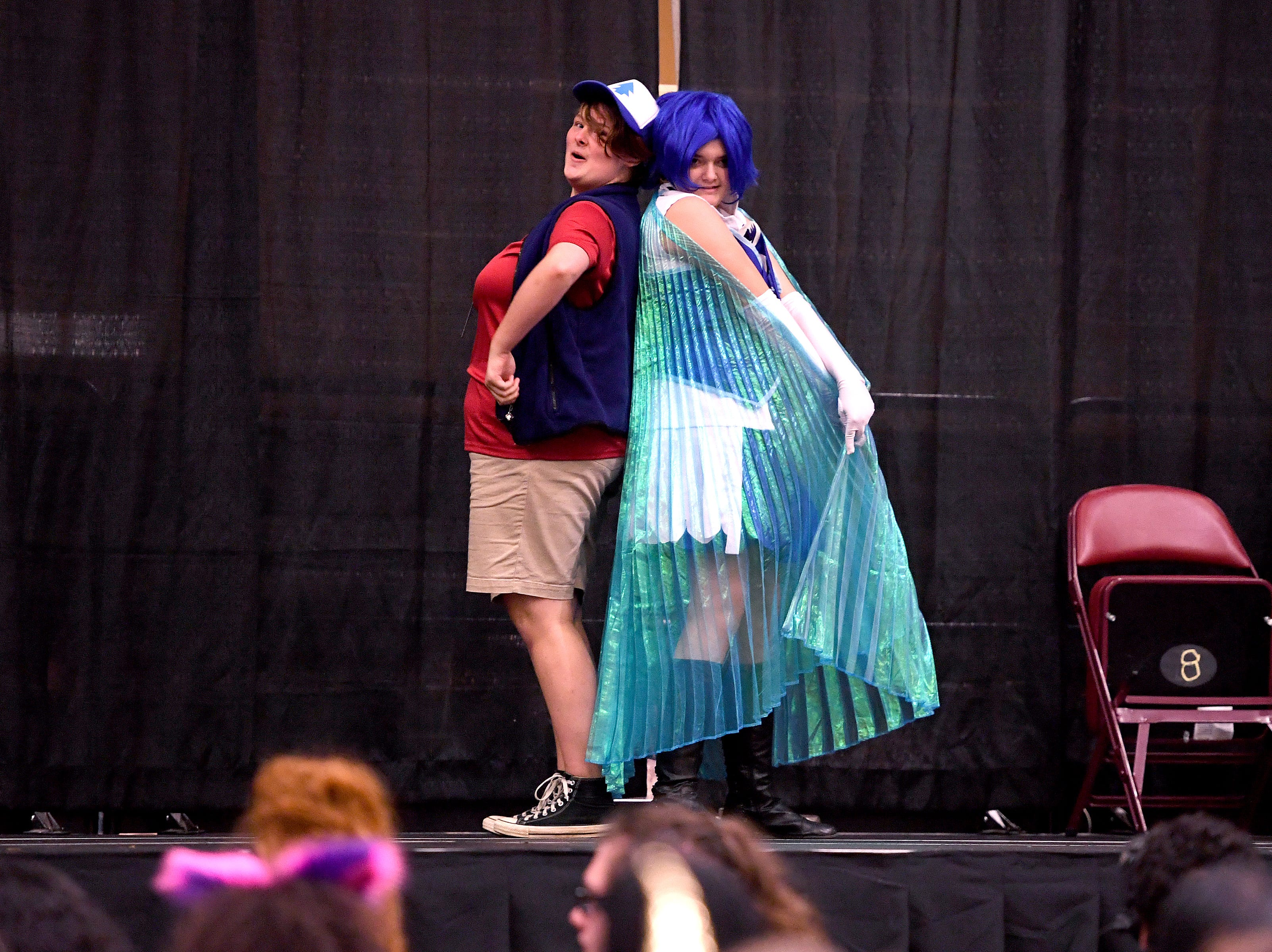 "Damiana Hylemon, or ""Dipper"", left, and Lacie Spangler perform in a cosplay lip sync battle during the Asheville Anime Regional Convention at the U.S. Cellular Center on Saturday, July 28, 2018."