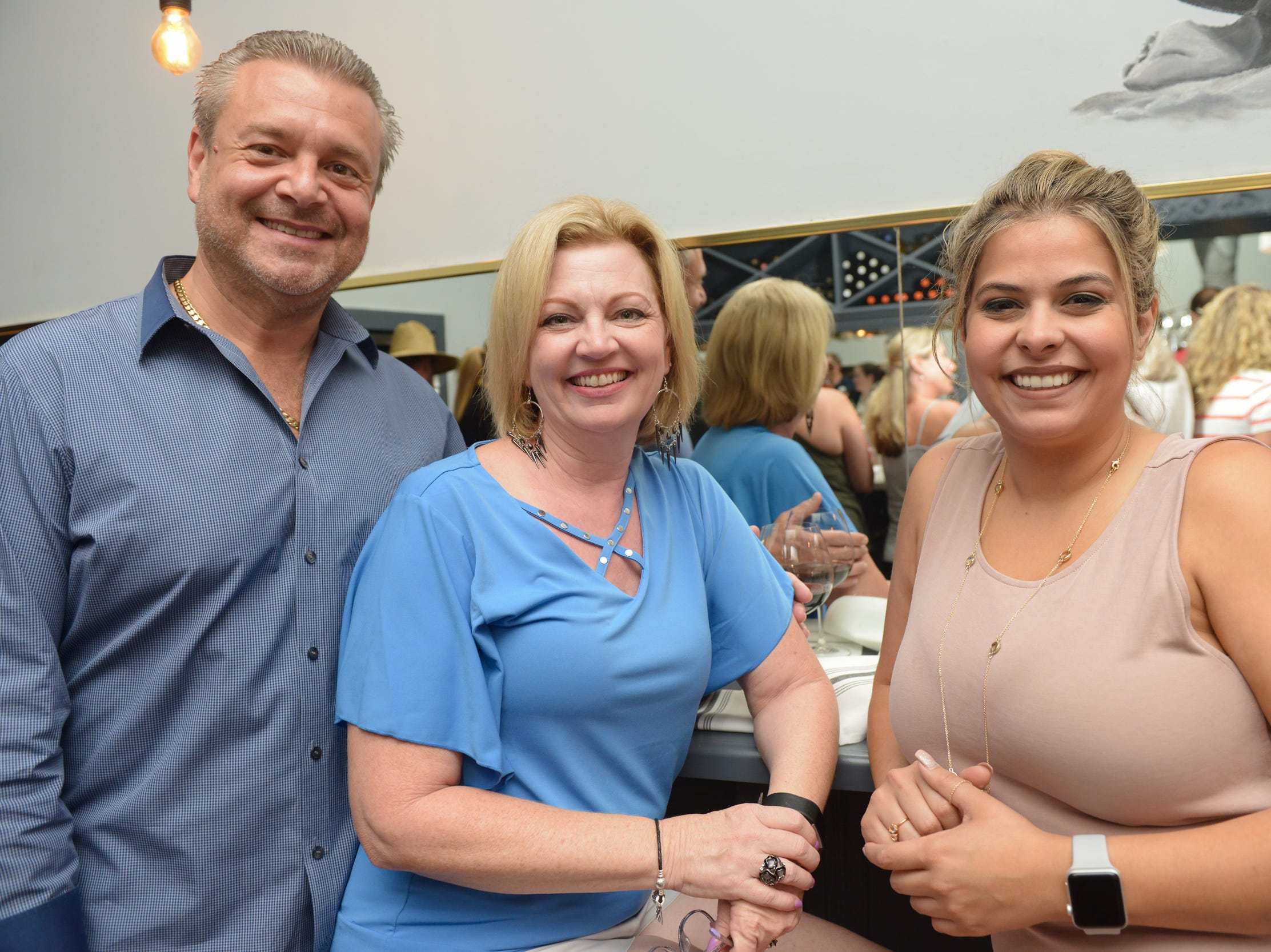 Richard Mazo, Keturah Mazo and Colleen Kuffel at a community gathering to kick off Shark Week, hosted by Florida Today at Crush XI in downtown Melbourne.