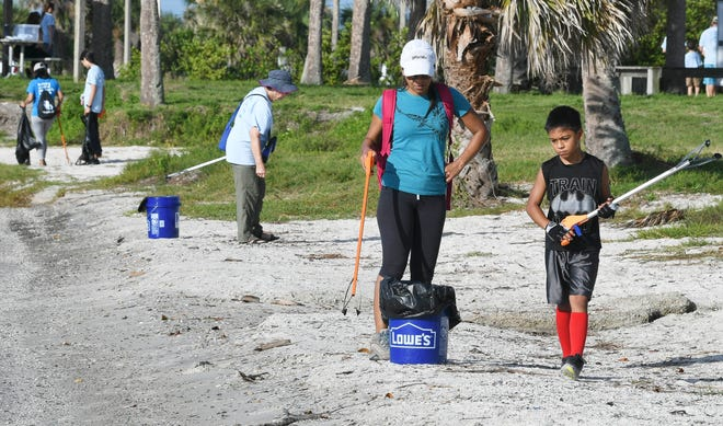 Volunteers collect trash from the area around Kelly Park East on Merritt Island, during the final stop for the 2018 Keep Brevard Beautiful/FLORIDA TODAY Summer Series cleanup