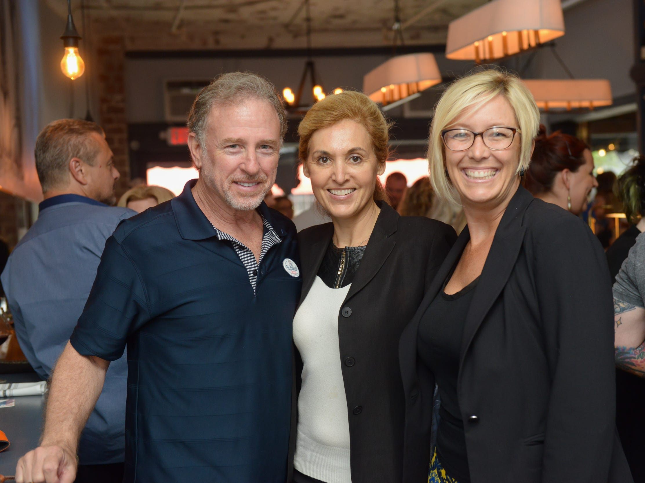 Larry Finkelstein, Valerie Bruel and Barbara Widerman at a community gathering to kick off Shark Week, hosted by Florida Today at Crush XI in downtown Melbourne.