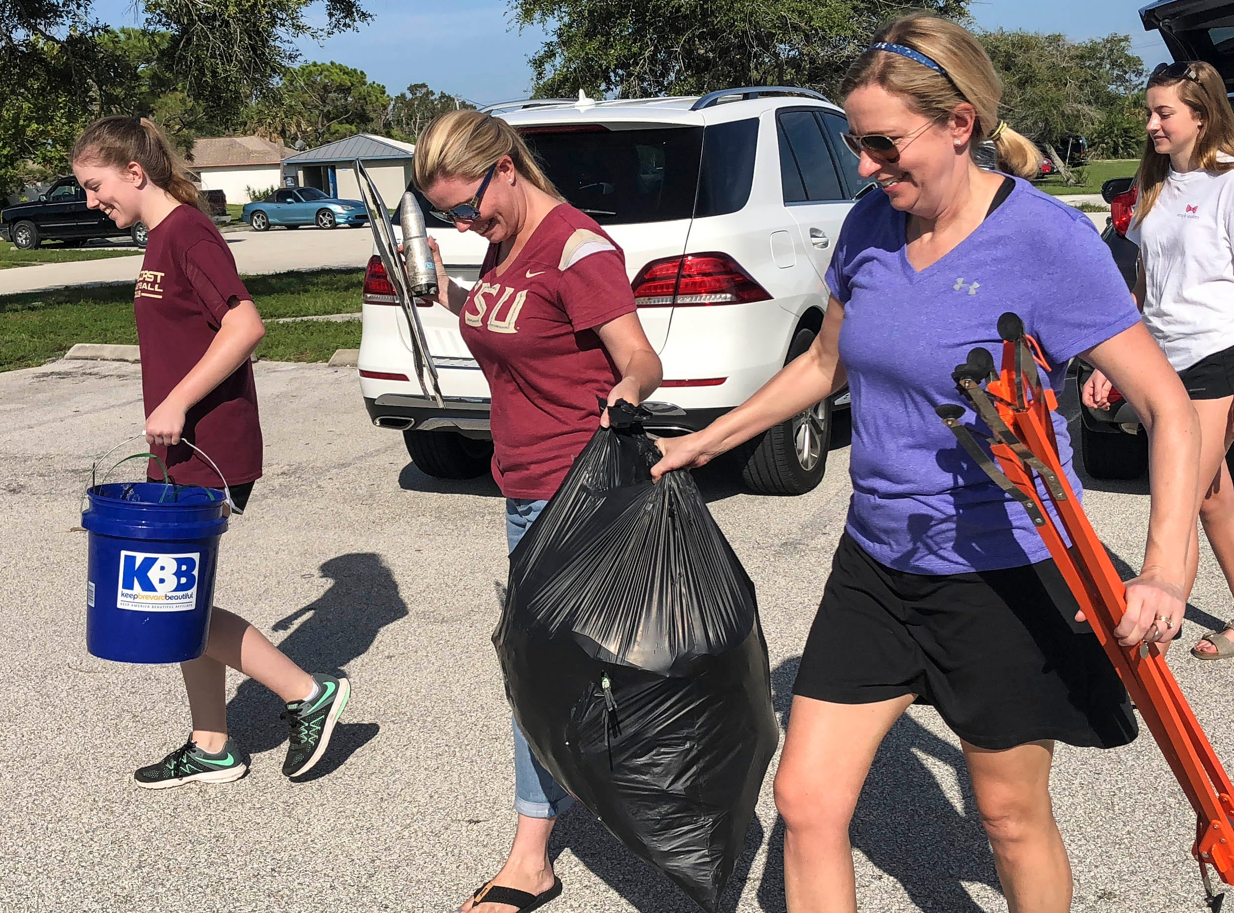 Volunteers collect trash from the area around Kelly Park East in Merritt Island Saturday. This was the final stop of the Keep Brevard Beautiful/FLORIDA TODAY Summer Series cleanup