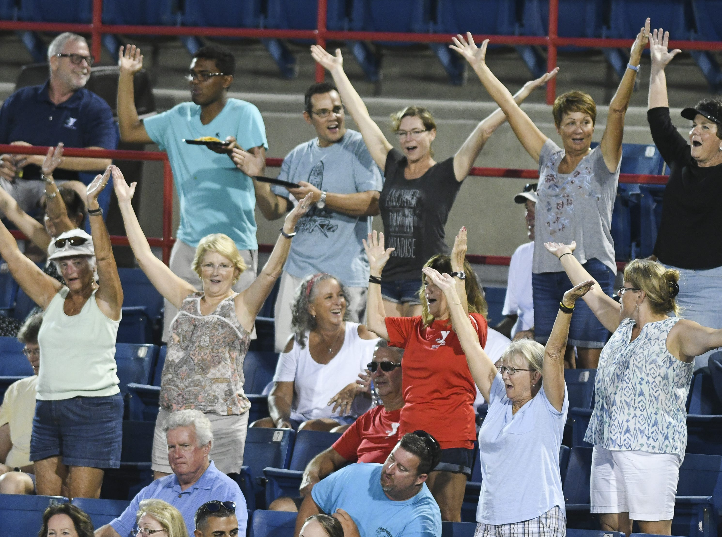 "Fans dance to the song ""YMCA"" during Friday's game between the USSSA Pride and Chicago Bandits in Viera."