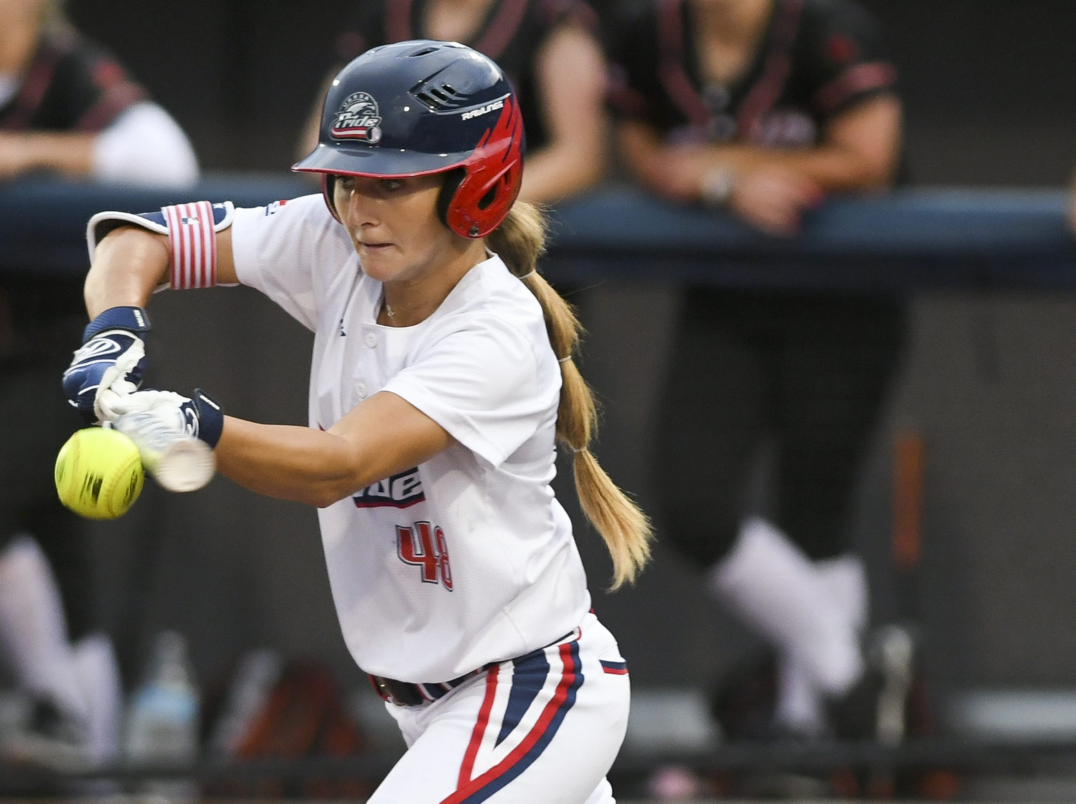 Allexis Bennett of the USSSA Pride bunts the ball during Friday's game in Viera.