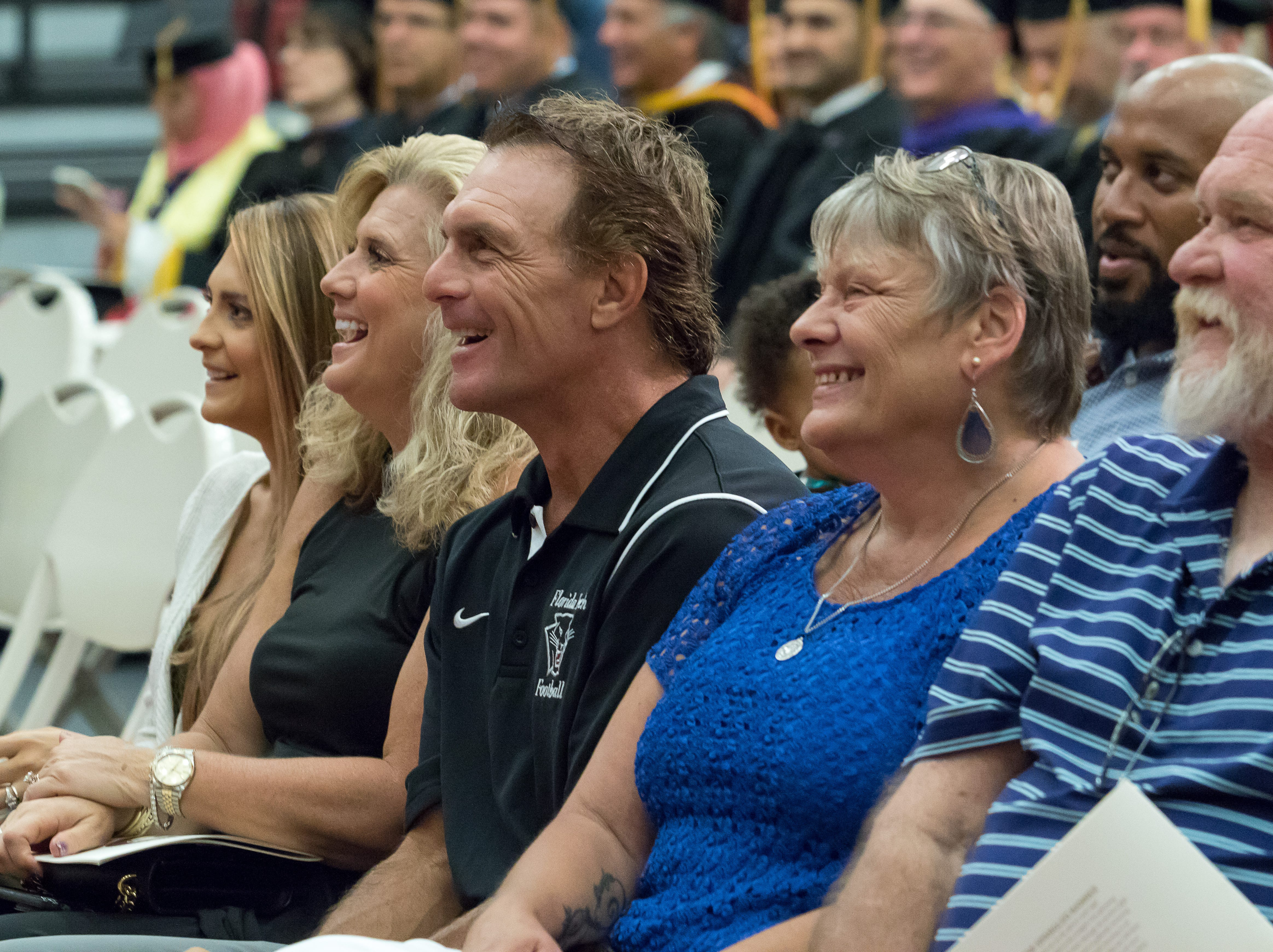 Florida Tech trustee and NFL legend Doug Flutie (center) attended the ceremony with his family to celebrate the graduation of his daughter Alexa Flutie-Sumner's husband, Ian Sumner, who graduated summa cum laude with a bachelor's degree in business administration/sport management.
