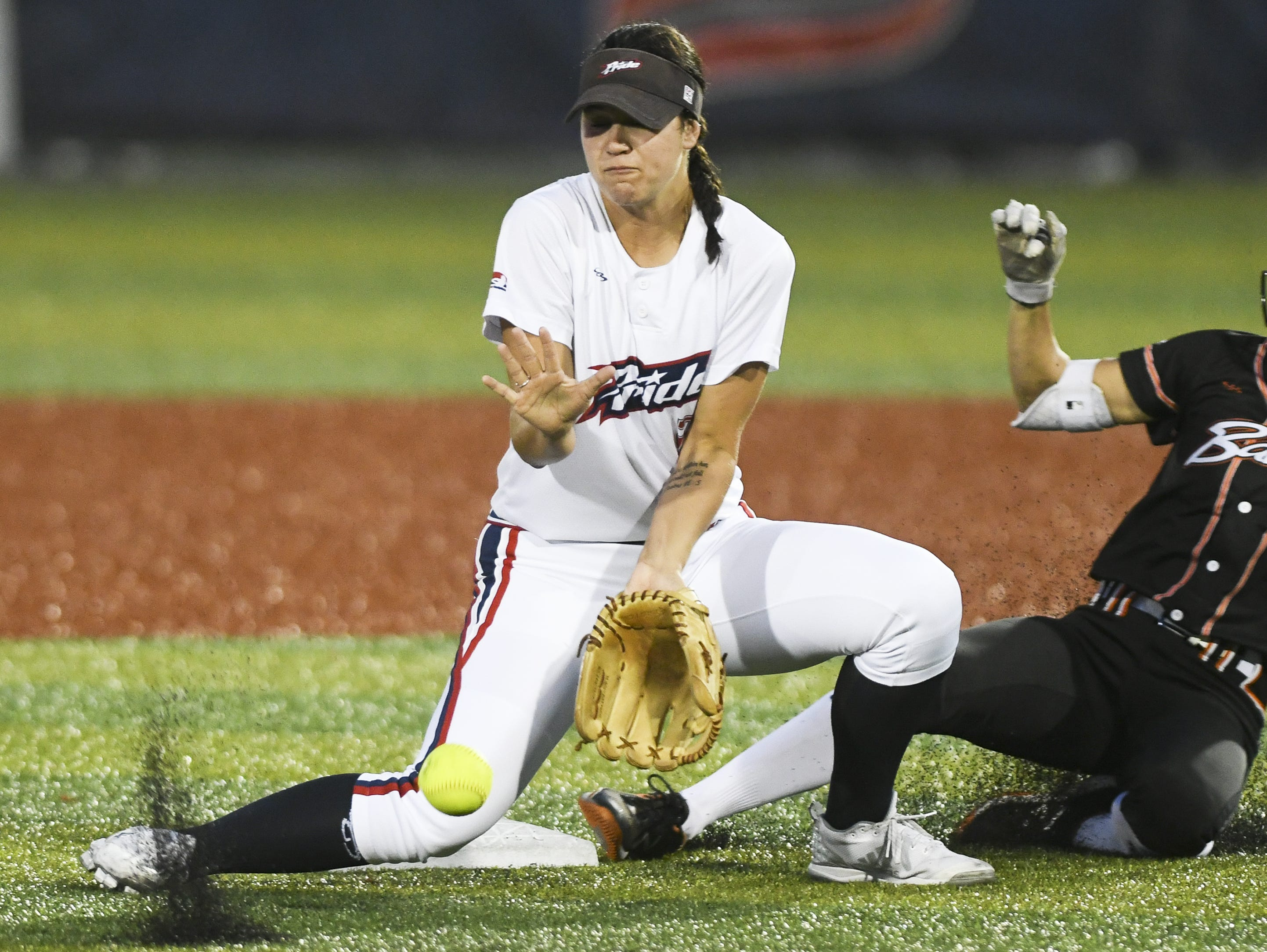Chicago's Brenna Moss makes it safely into second base as the throw arrives late the Nicole DeWitt of the USSSA Pride during Friday's game in Viera.