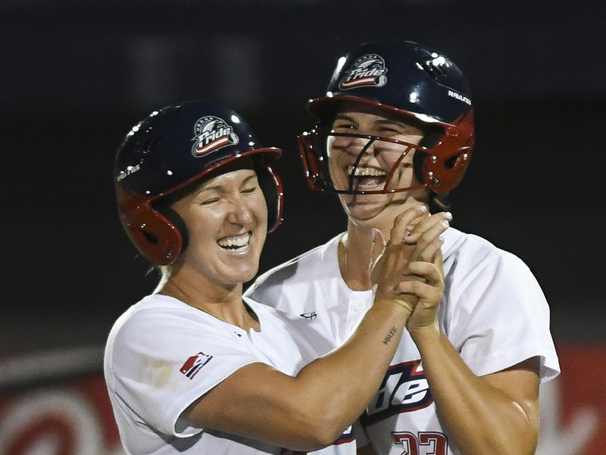 Shelby Pendley of the USSSA Pride celebrates after drawing a bases loaded walk to score teammate Nicole DeWitt and win the game against Chicago Friday in Viera.