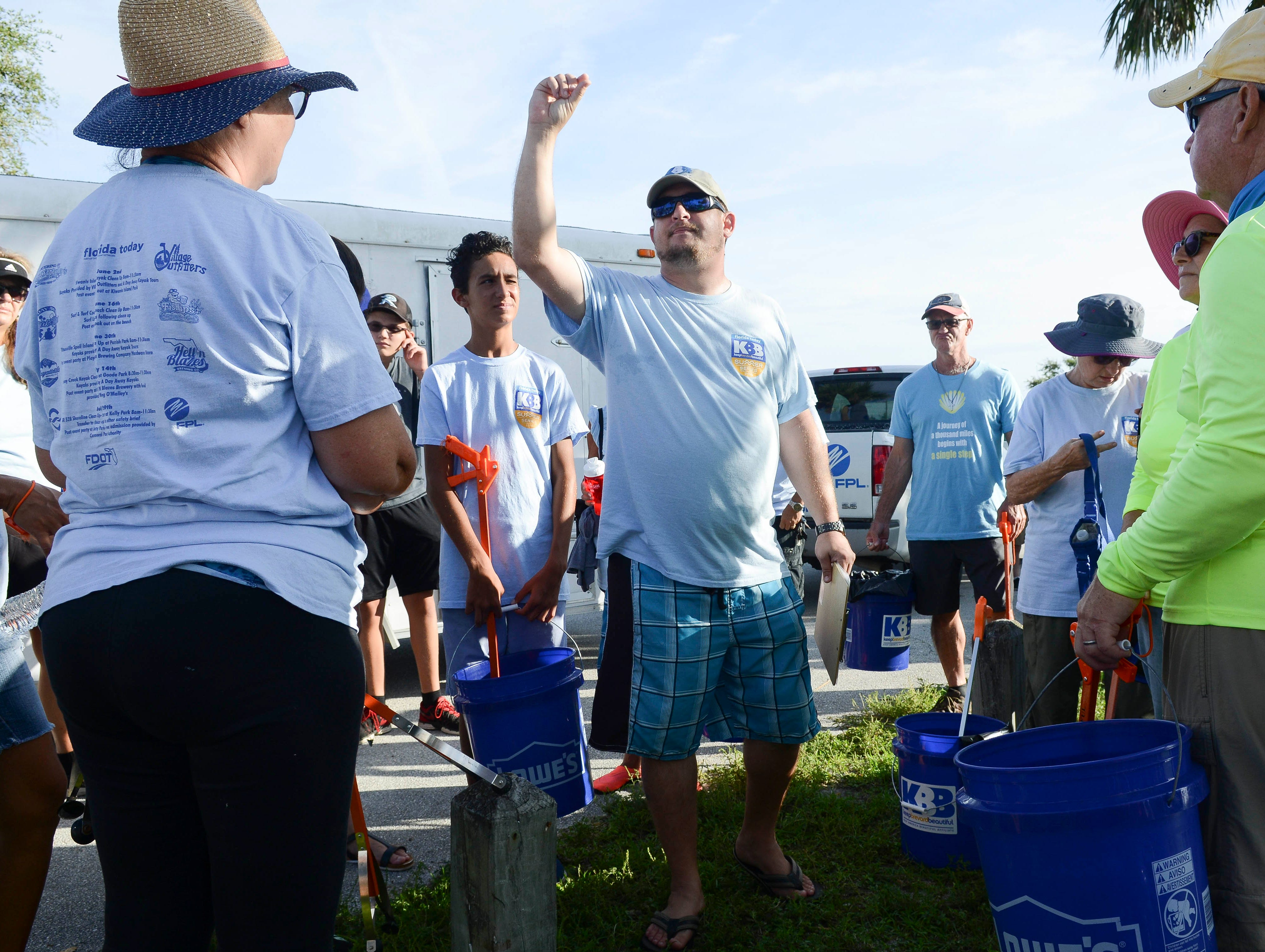 Bryan Bobbitt of Keep Brevard Beautiful directs the crowd at Kelly Park East in Merritt Island Saturday. This was the final stop of the Keep Brevard Beautiful/FLORIDA TODAY Summer Series cleanup