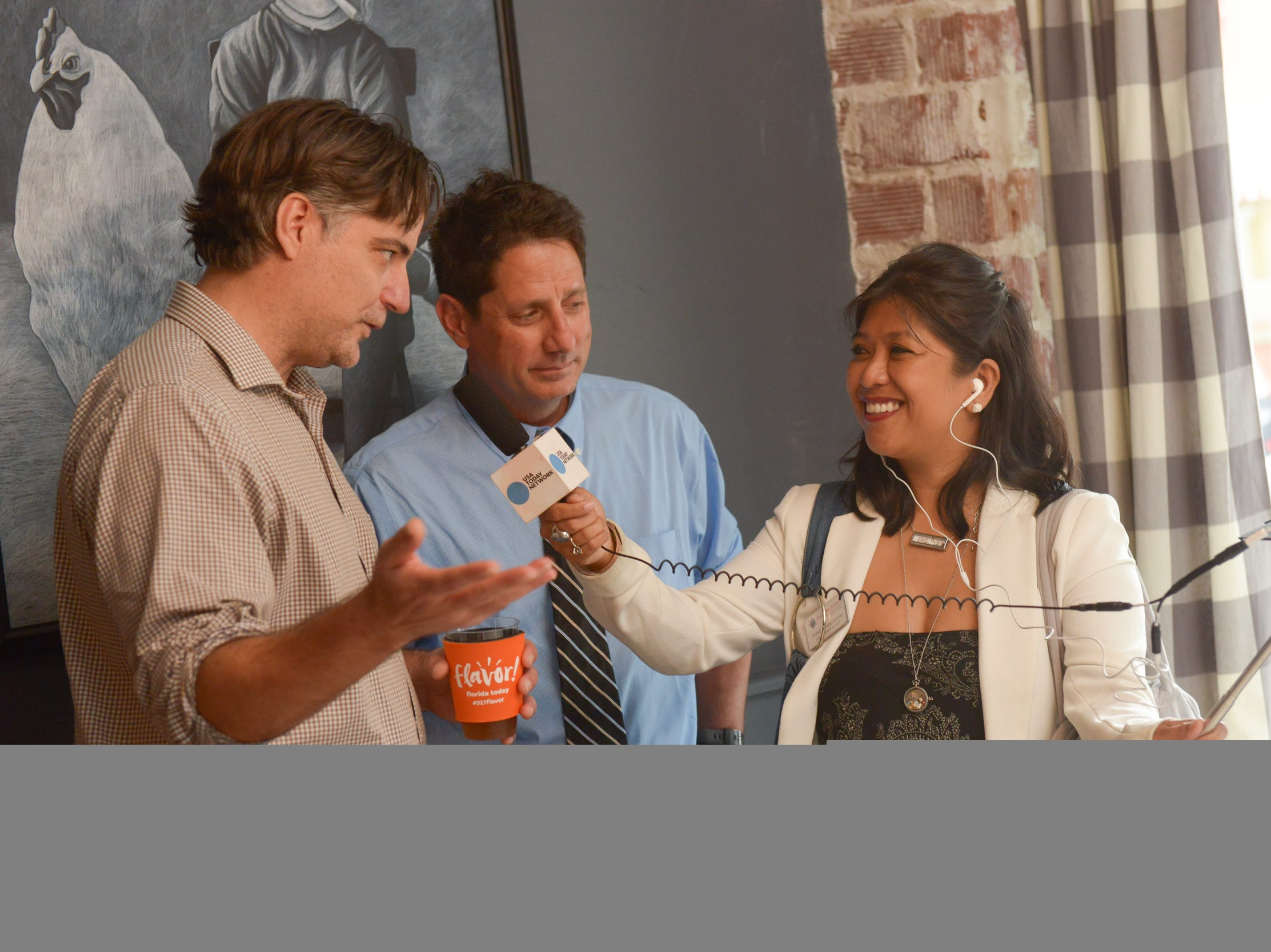 Senior Digital Producer Jennifer Sangalang interviews environmental reporter Jim Waymer and business editor Wayne T. Price at a community gathering to kick off Shark Week, hosted by Florida Today at Crush XI in downtown Melbourne.