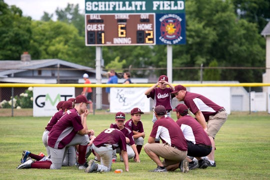 The Lyndon team huddles after the final out of their 2-1 loss to South Burlington during the 2018 Little League state championship game at Schifilliti Park.