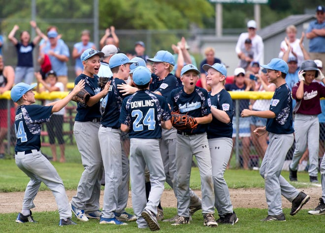South Burlington players celebrate the final out of their 2-1 win over Lyndon in Saturday's Little League state championship game at Schifilliti Park.