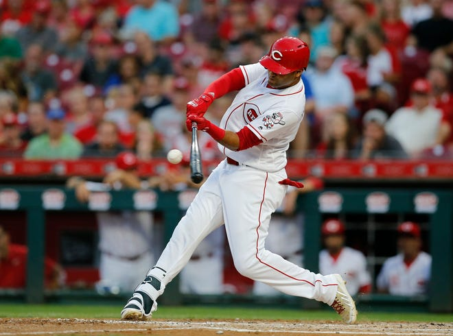 Cincinnati Reds right fielder Mason Williams (46) hits a three-run home run, his first hit as a Cincinnati Red, in the fourth inning of the MLB National League game between the Cincinnati Reds and the Philadelphia Phillies at Great American Ball Park in downtown Cincinnati on Friday, July 27, 2018. The Reds won 6-4.