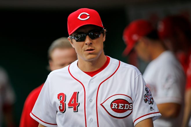 Cincinnati Reds starting pitcher Homer Bailey (34) walks the dugout on an off night in the first inning of the MLB National League game between the Cincinnati Reds and the Philadelphia Phillies at Great American Ball Park in downtown Cincinnati on Friday, July 27, 2018.