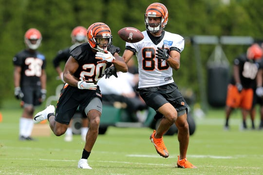 Cincinnati Bengals wide receiver Josh Malone (80) makes a catch as Cincinnati Bengals cornerback KeiVarae Russell (20) defends during Cincinnati Bengals training camp on the practice fields next to Paul Brown Stadium, Thursday, July 26, 2018, in Cincinnati.