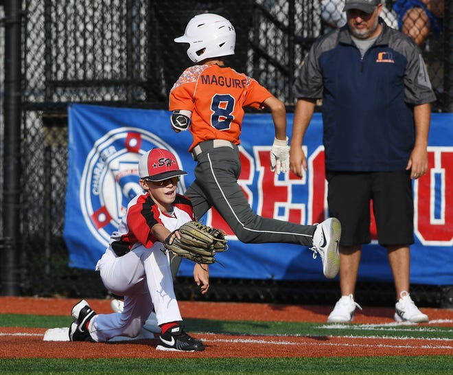 Somerset Hills vs Millville American Youth in the Joe Graziano Little League NJ State Tournament in Secaucus on Saturday, July 28, 2018.  S #5 Connor Laverty gets M #8 Gavin Maquire out at first in the first inning.