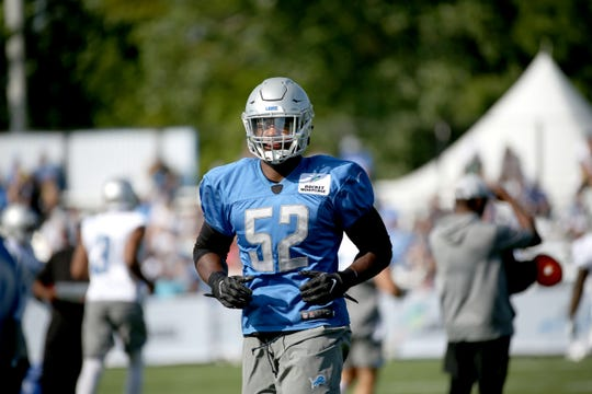 Detroit Lions linebacker Christian Jones warms up during training camp in Allen Park on Saturday, July 28, 2018.