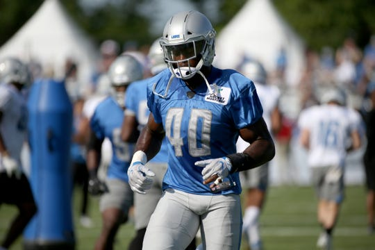 Detroit Lions linebacker Jarrad Davis warms up during training camp in Allen Park on Saturday, July 28, 2018.