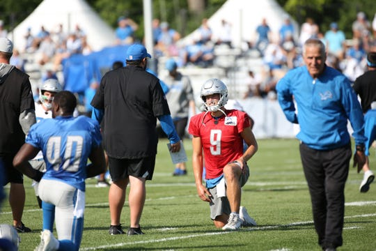 Detroit Lions Head Coach Matt Patricia talks with Quarterback Matthew Stafford as he warms up during the Detroit Lions training camp at their practice facility in Allen Park on Sat. July 28, 2018.