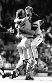 Lance Parrish congratulates his no-hit pitcher, Jack Morris, with a bear hug against  the Chicago White Sox in Chicago to open the season in 1984.