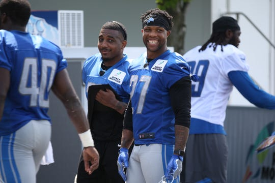 Safety Glover Quin talks with other players after the Detroit Lions training camp at their practice facility in Allen Park on Sat. July 28, 2018.