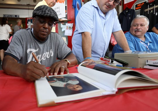 Lou Whitaker signs a portrait of himself in a book at Seventh Inning Stretch on Main Street in downtown Cooperstown, N.Y. on Saturday, July 28, 2018. Whitaker is in town for an autograph session and to support his Detroit Tigers teammates Alan Trammell and Jack Morris.