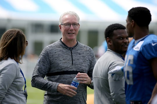 Detroit Lions president Rod Wood talks with staff and players after the Detroit Lions training camp at their practice facility in Allen Park on Sat. July 28, 2018.